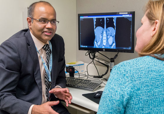 Surgeon Kiran Turaga, MD, meets with a patient.
