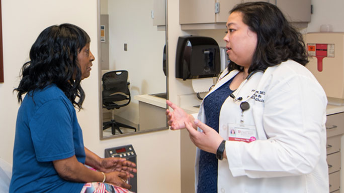 Selina Chow, MD, in geriatric oncology clinic with patient