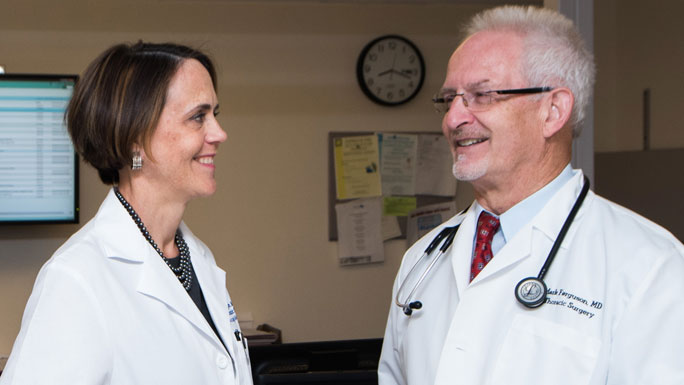 Thoracic surgeons Jessica Donington, MD, and Mark Ferguson, MD