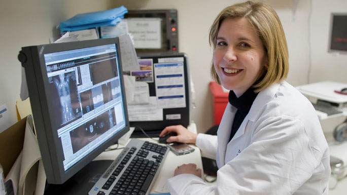 Tara Henderson, MD, MPH, working at a computer