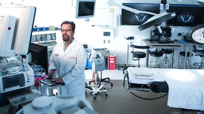Neil H. Hyman, MD, in an operating room in the Center for Care and Discovery