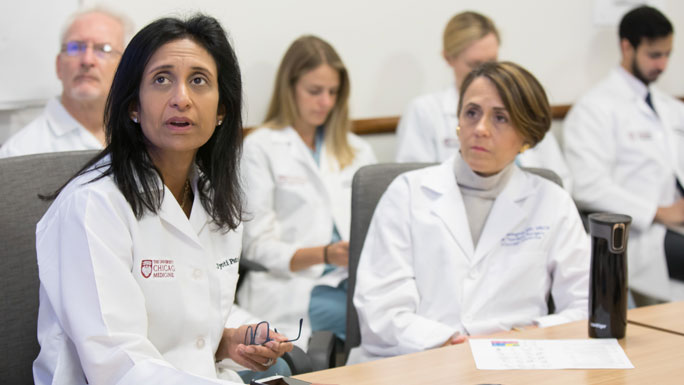 Jyoti Patel, MD, and Jessica Donington, MD, in a thoracic oncology tumor board meeting