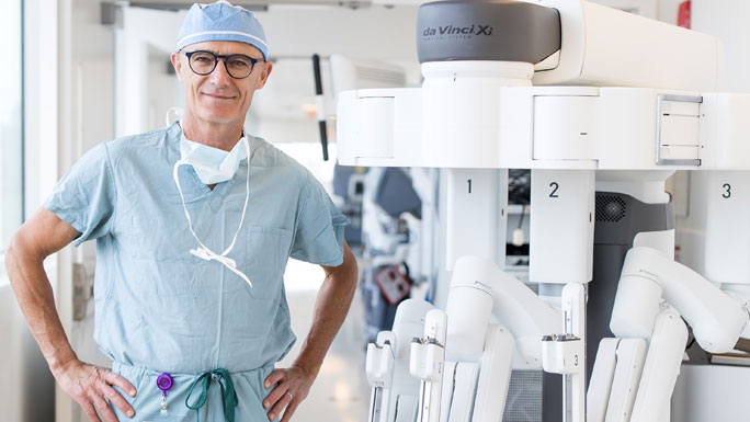 Urologist Arieh Shalhav, MD, with a da Vinci surgical robot