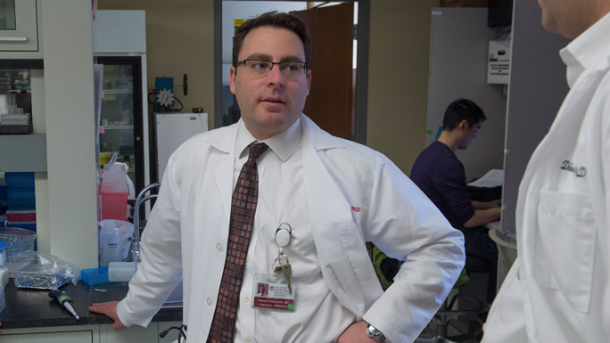 Russell Szmulewitz, MD, in lab