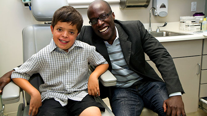 Pediatrics patient Ty Arroyo with surgeon Russell Reid, MD, PhD, from pediatric plastic and reconstructive surgery, and part of the Craniofacial Anomalies Multidisciplinary Program (CAMP).
