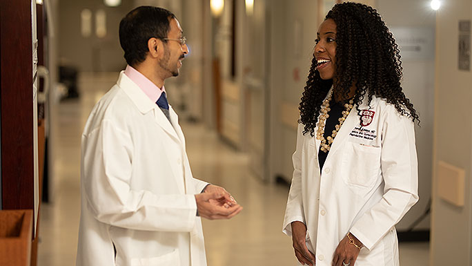 Reproductive endocrinologists A. Musa Zamah, MD, PhD, and Amanda Adeleye, MD, having a conversation