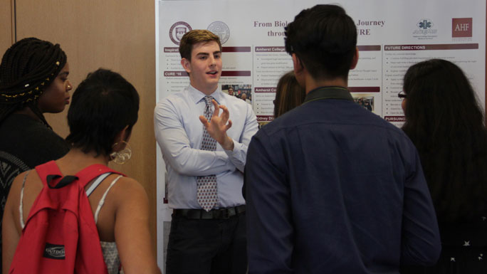 male student presenting research to fellow students