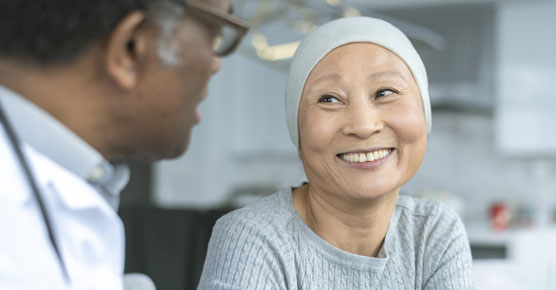 Asian female cancer patient with male doctor