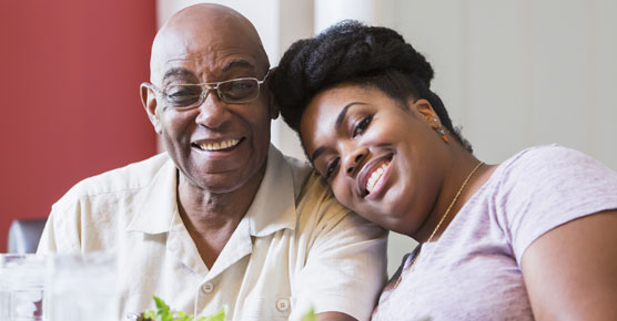 African-American father and caregiver daughter