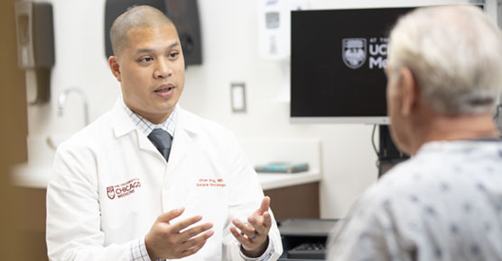 Oliver Eng, MD, meets with a patient in clinic