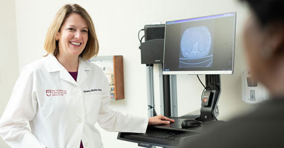 Olwen Hahn, MD, with CT scan and patient
