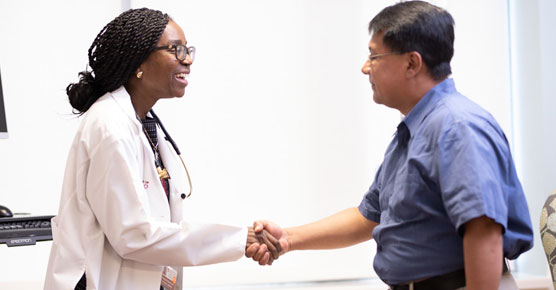 Olatoyosi Odenike, MD, shaking hands with patient