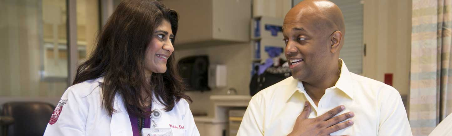 Sonali Smith, MD, and Clayton Harris, lymphoma patient