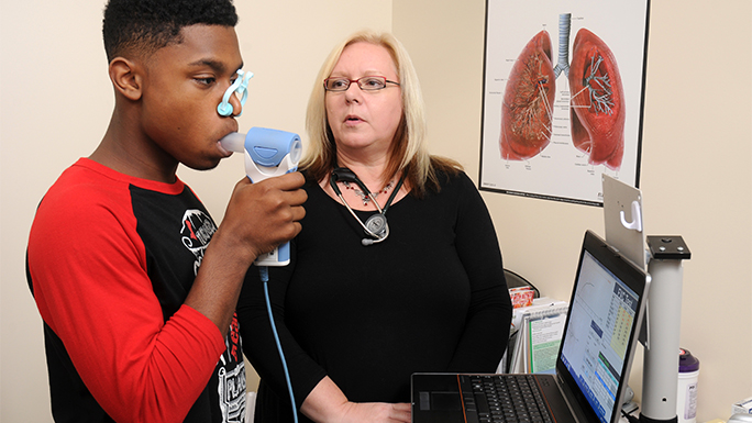 Dr. Brenda Giles with respiratory therapy patient