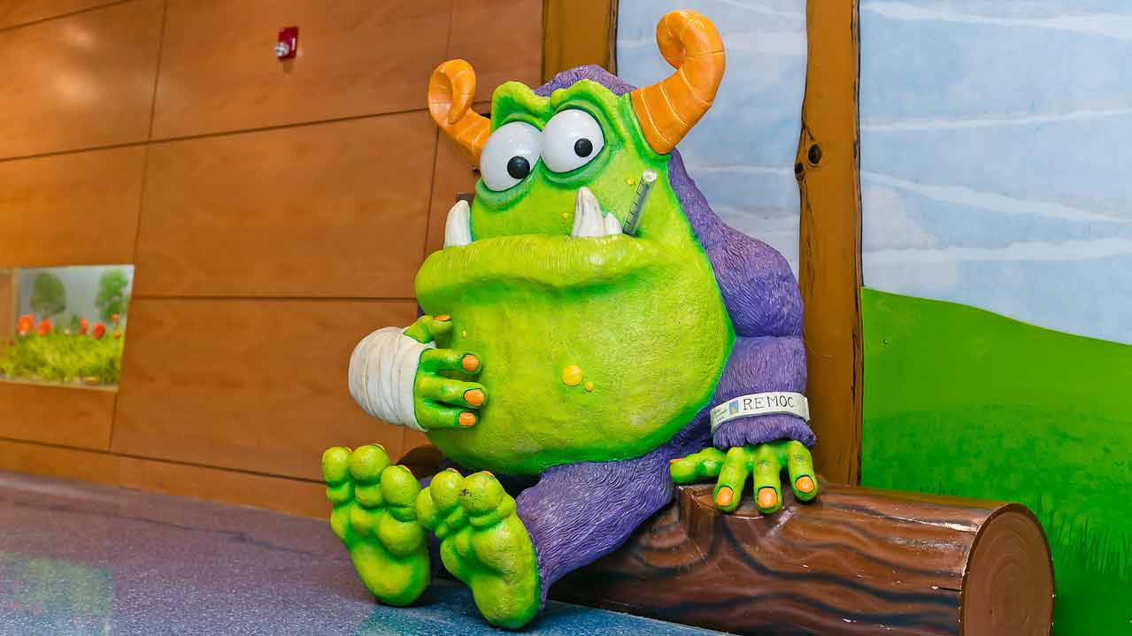 Remoc, Comer Children's Hospital's friendly monster mascot, sits in the hospital lobby.