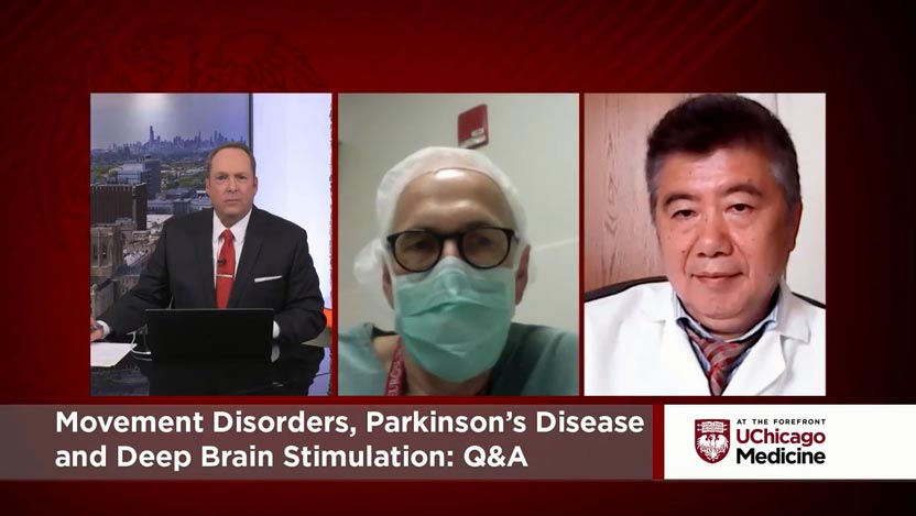 Neurologist Dr. Tao Xie and neurosurgeon Dr. Peter Warnke discussing movement disorders, parkinson