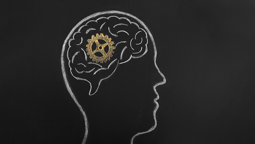 Chalkboard drawing of a brain with a gear