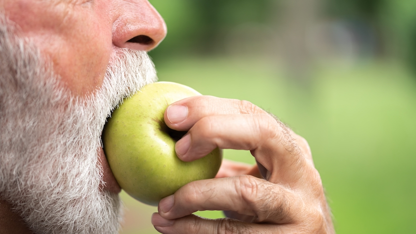 person biting into apple