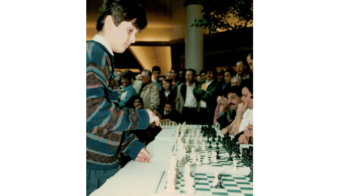 Lev Becker playing chess as a child