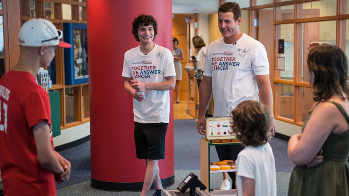 Anthony Bendy and Anthony Rizzo visit the Comer Children's Child Life Playroom.