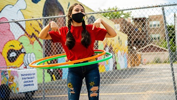 Masked girl hula hooping