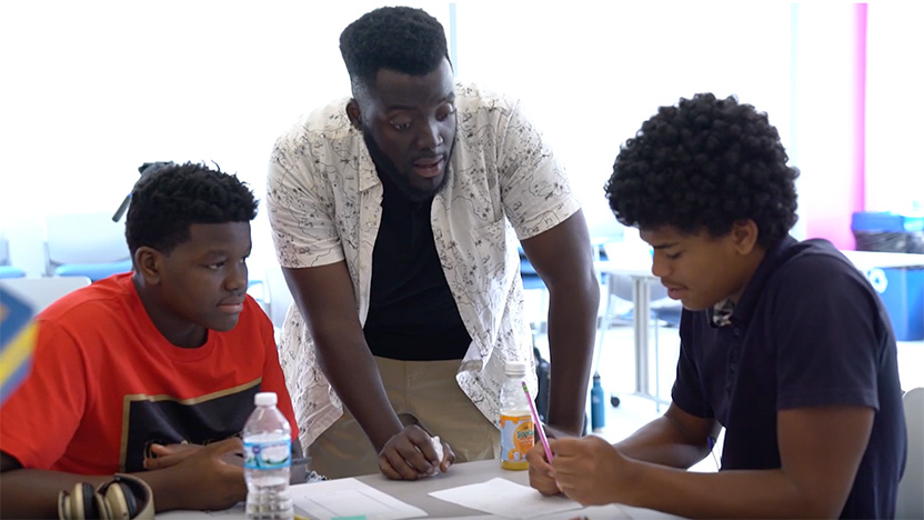 "Michael ""MJ"" Johnson, Community Engagement Specialists, with two students from the Design Thinking Lab"