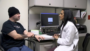 GERD patient Michael Meadows talks with Dr. Vigneswaran about anti-reflux surgery