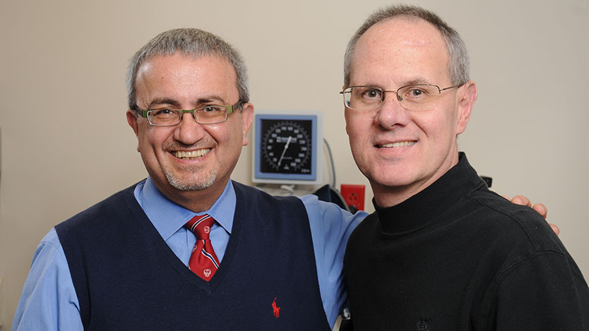 Issam Awad, MD, (left) director of neurovascular surgery with patient Joseph Pagone