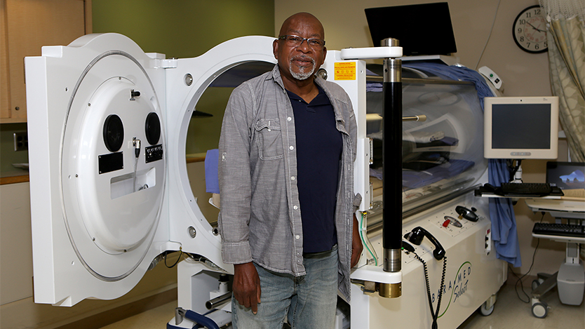 Kelley Norman with Hyperbaric Oxygen Therapy chamber