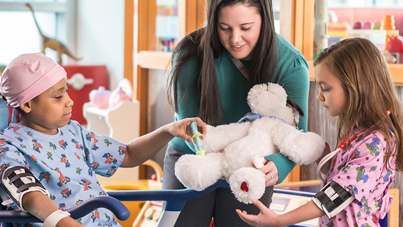 Child Life specialist with children in the playroom