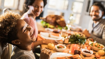 A child with celiac disease eating a holiday meal with family