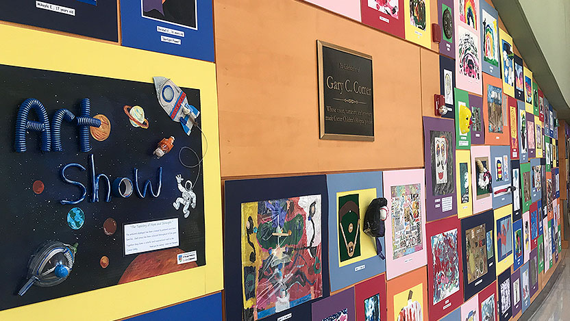 Wall of artwork displayed in 2019 Comer Art Show