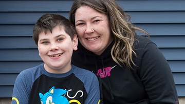 Eleven-year-old Zachary Kurek, now seizure-free after laser hemispherectomy, with his mom Amanda Morey