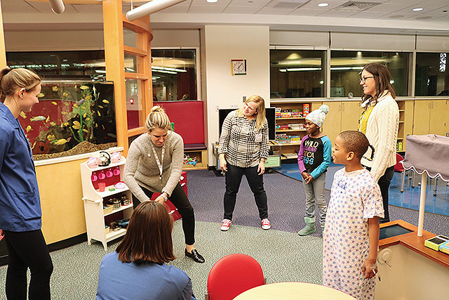 Improv comedy troupe Humor for Hope performs for patients in the Comer Children's playroom