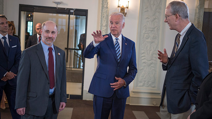 Vice President Joe Biden talks with Prof. Robert Grossman, PhD, (left) Department of Medicine and the College and Senior Fellow with the Computation Institute, and Louis M. Staudt, MD, PhD, (right) with the NCI, as they launch the NCI Genomic Data Commons (GDC), a system designed and developed by the Center for Data Intensive Science at the University of Chicago and presented Monday, June 6, 2016, at their office in the Shoreland in Chicago.