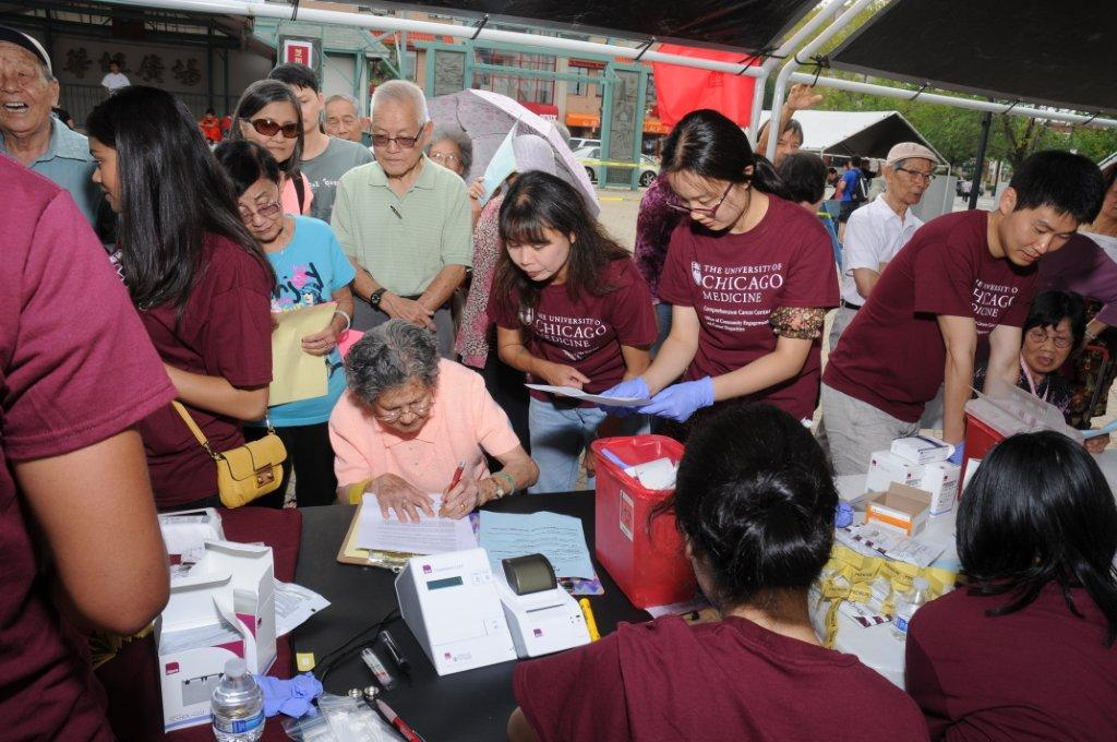 Asian Americans being screened for diabetes at a health fair in Chinatown, 2014