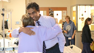 Triple organ transplant patient, Sarah McPharlin, hugs Dr. Valluvan Jeevanandam after transplant surgeries