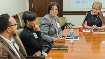 Medical Center Trustee Ellie Block meets with Brenda Battle, community partners, and staff