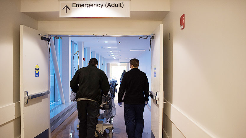 Team wheels trauma patient into adult emergency department at UChicago Medicine