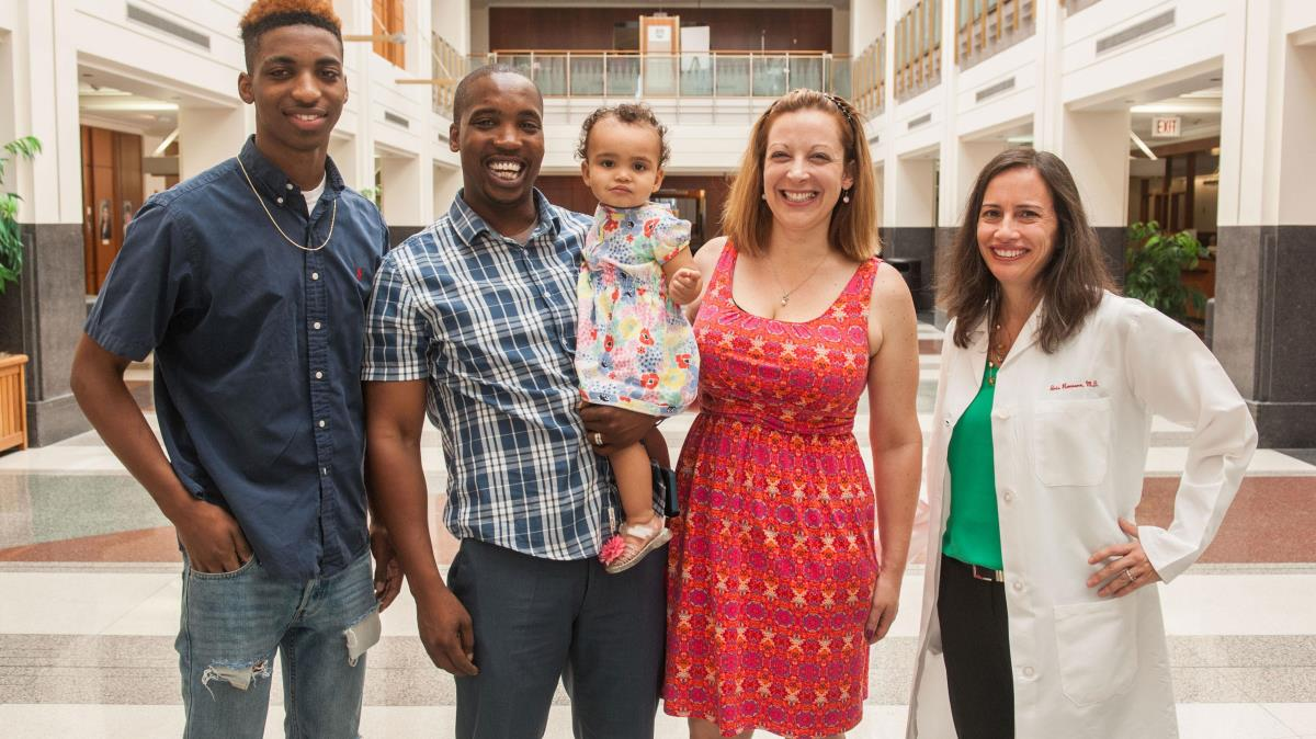 Kate McClinton and her family meet with Iris Romero, MD, an obstetrician at the University of Chicago Medicine Family Birth Center, after the May 2015 birth of Kate