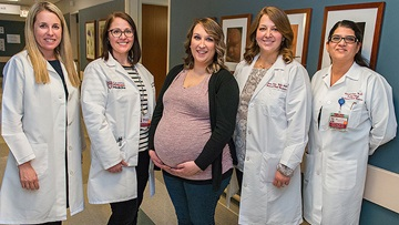 Jessica Darnell with specialists on her fetal center care team, including Dr. Kelly Nelson, nurse coordinator Amy Cuevas, Dr. Julia Bregand-White and Dr. Sarosh Ran
