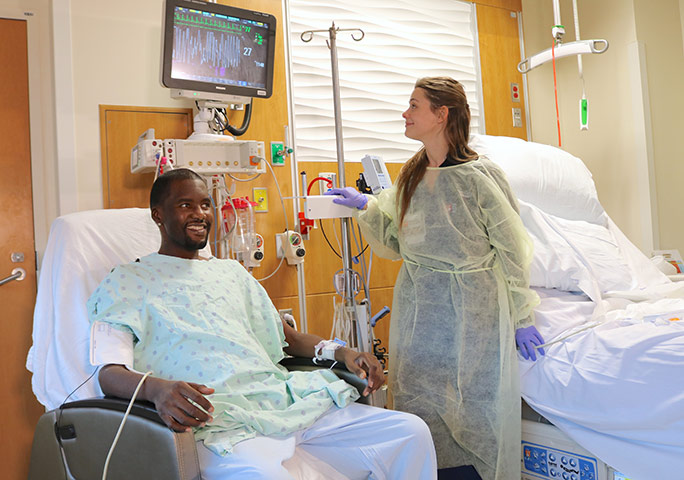 Transplant patient, Daru Smith, with a transplant nurse