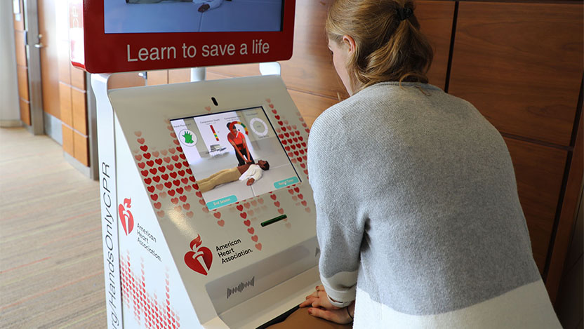 Interactive kiosks train the public on how to perform CPR