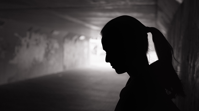 Depressed young woman in tunnel