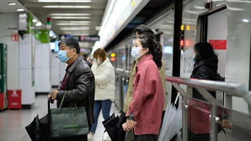 Travelers wearing face masks