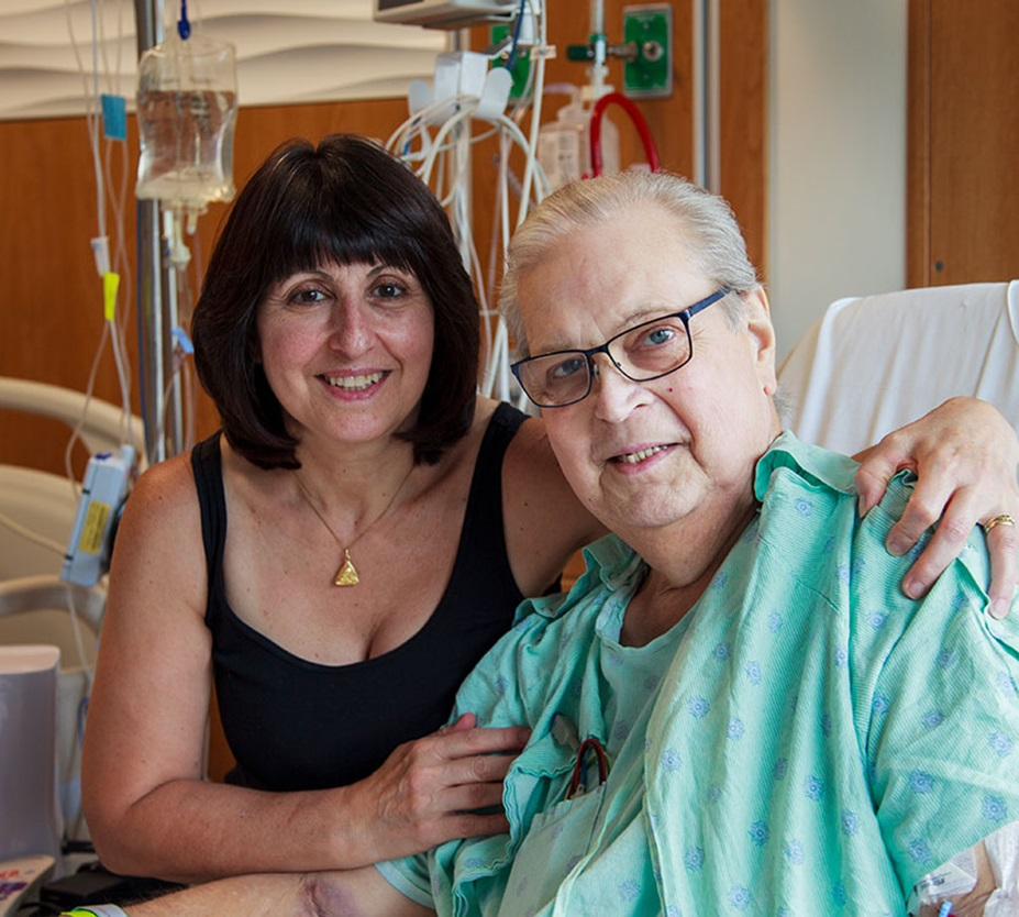 Joseph Anderson and his wife in the hospital after his lung transplant