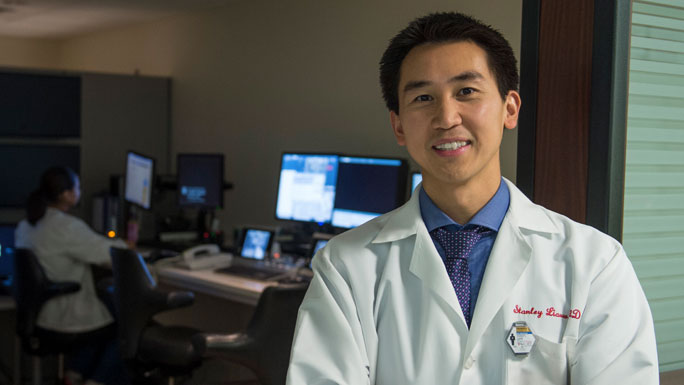 Stanley Liauw, MD, radiation oncologist, standing in front of a radiation therapy planning room