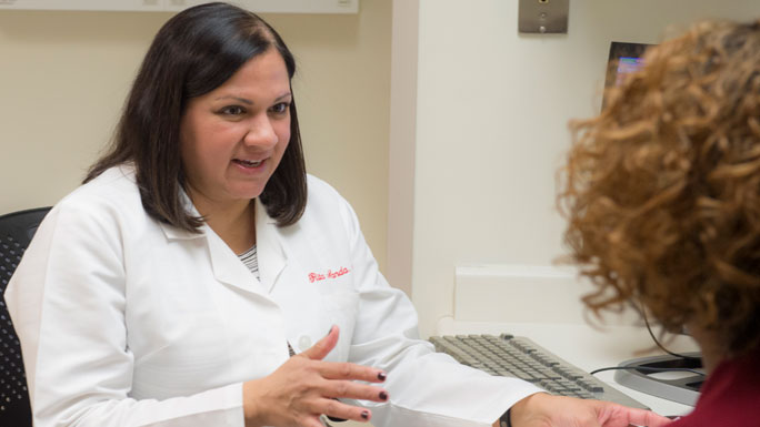 Rita Nanda, MD, medical oncologist, speaks with a patient