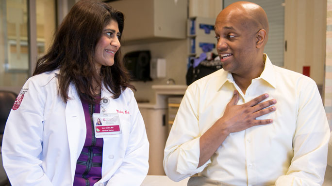 Sonali Smith, MD, and lymphoma patient, Clayton Harris
