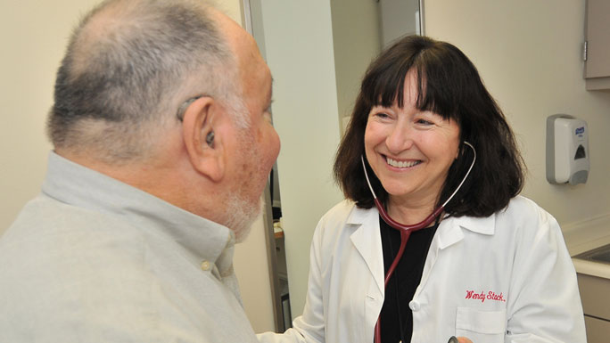 Medical oncologist Wendy Stock, MD, with a patient in clinic